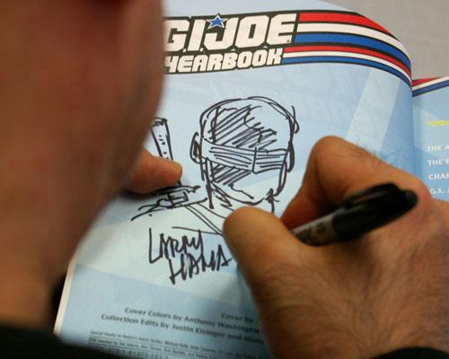 Larry Hama signing G.I. Joe at Hub Comics