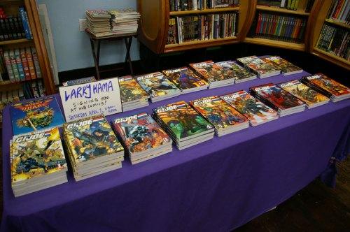 Larry Hama signing at Hub Comics G.I. Joe books graphic novels on table